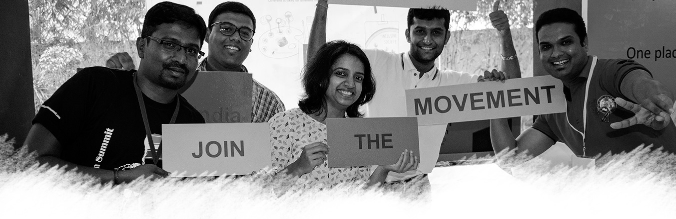 Some Enable India Staff holding placards that read Join. the. Movement.