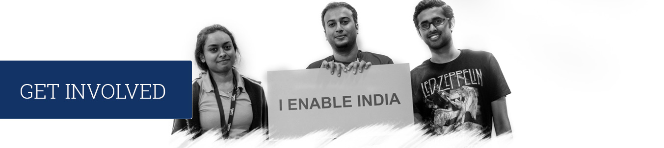 Volunteers holding placard that reads I enable india.