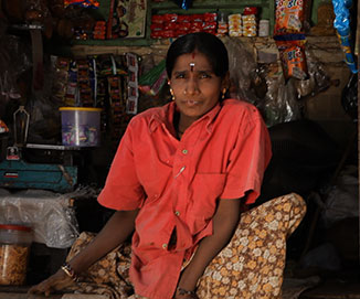 Woman with physical disability in kirana shop