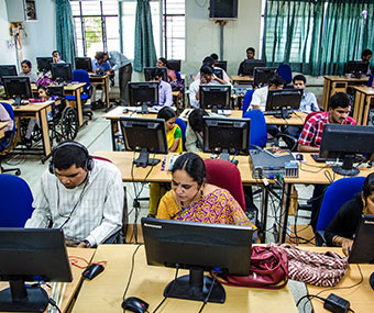 Visually impaired participants working on computers in a training