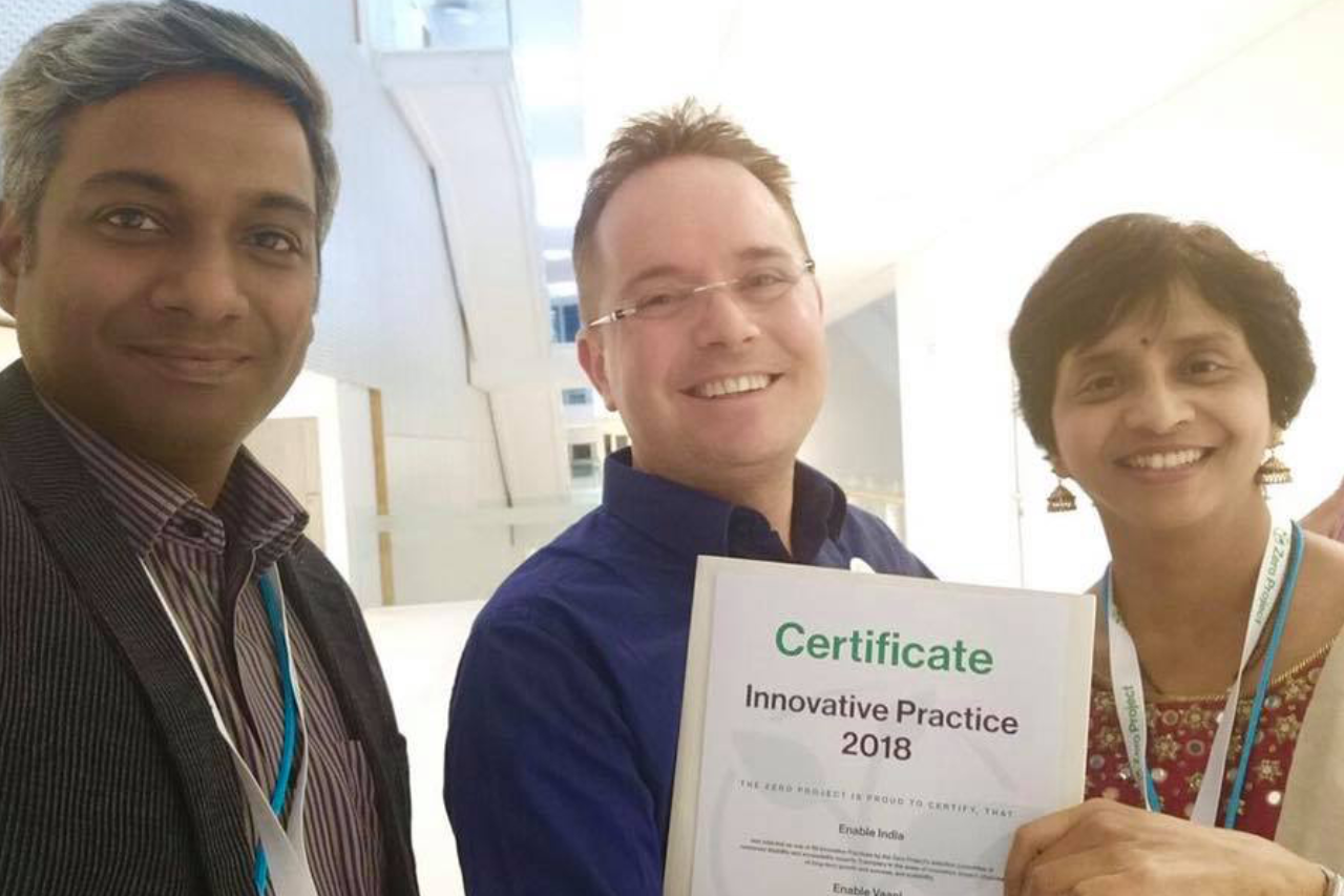 Shanti Raghavan, Julian Tarbox and Top Official of Onion Dev with the certificate of award