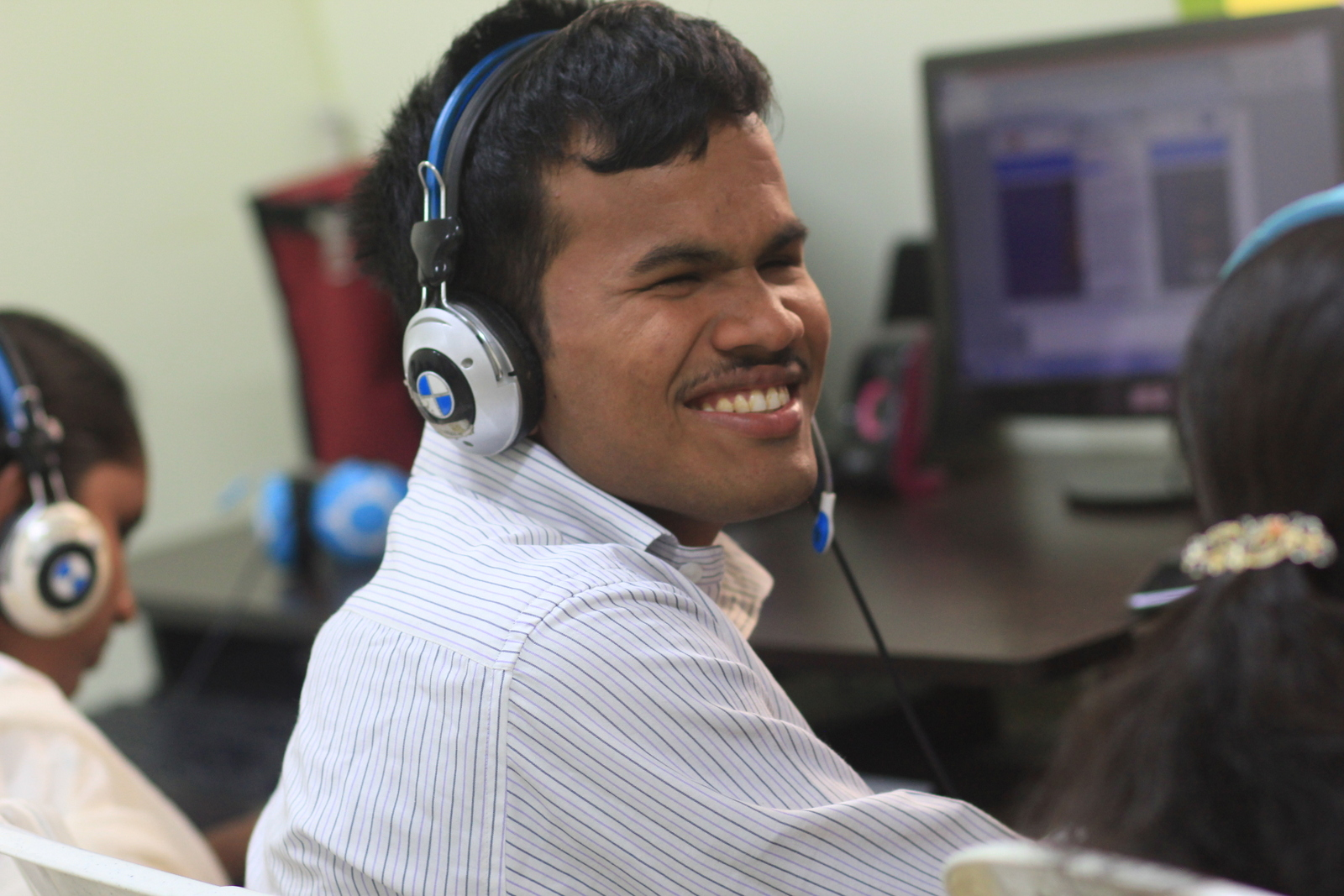 Person with vision impairment smiling with headset